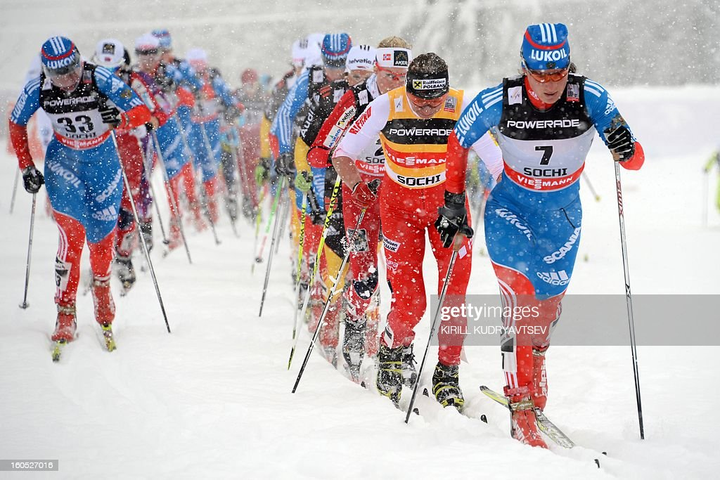 Russia's Yulia Tchekaleva (R) and Poland's Justyna Kowalczyk (2nd R) compete during Ladies' 7,5 km classic + 7,5 km freestyle Skiathlon of FIS Cross Country skiing World Cup at Laura Cross Country and Biathlon Center in Russian Black Sea resort of Sochi on February 2, 2013. Norway's Kristin Stoermer Steira took the first place ahead of Russia's Yulia Tchekaleva and Germany's Nicole Fessel.