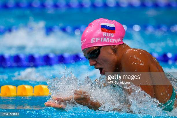 Russia's Yuliya Efimova competes in a heat of the women's 50m breaststroke during the swimming competition at the 2017 FINA World Championships in...