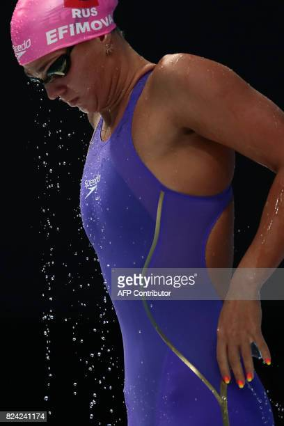 Russia's Yuliya Efimova prepares to compete in a semifinal of the women's 50m breaststroke during the swimming competition at the 2017 FINA World...