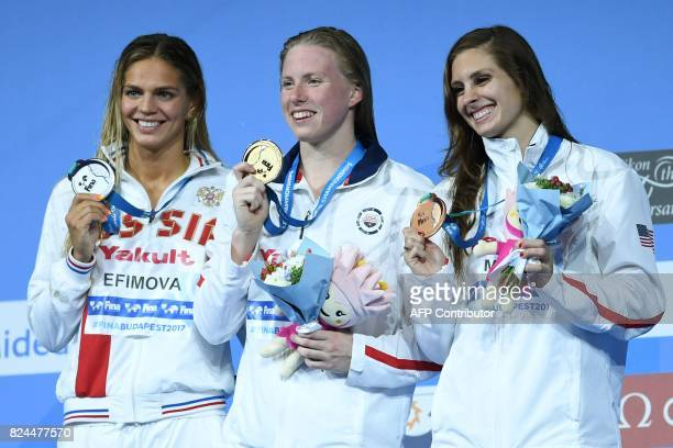Russia's Yuliya Efimova US Lilly King and US Katie Meili celebrate on the podium after the final of the women's 50m breaststroke during the swimming...