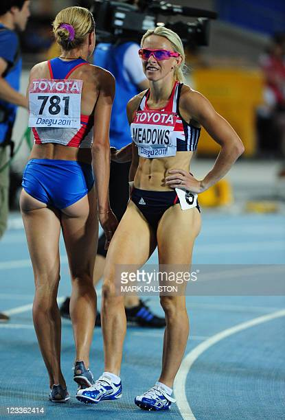 Russia's Yuliya Rusanova and Britain's Jennifer Meadows react after competing in the women's 800 metres semifinals at the International Association...