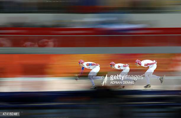 Russia's Yuliya Skokova Russia's Olga Graf and Russia's Ekaterina Lobysheva compete in the Women's Speed Skating Team Pursuit Final B at the Adler...