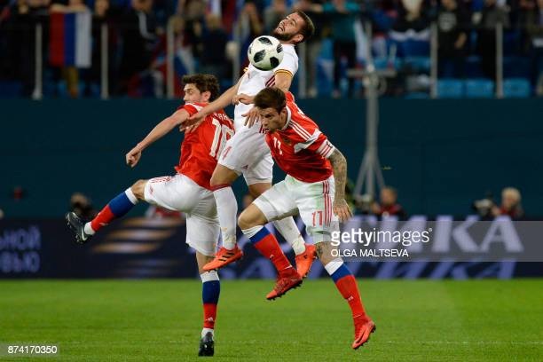 Russia's Yury Zhirkov Fedor Smolov and Spain's Nacho vie for the ball during an international friendly football match between Russia and Spain at the...