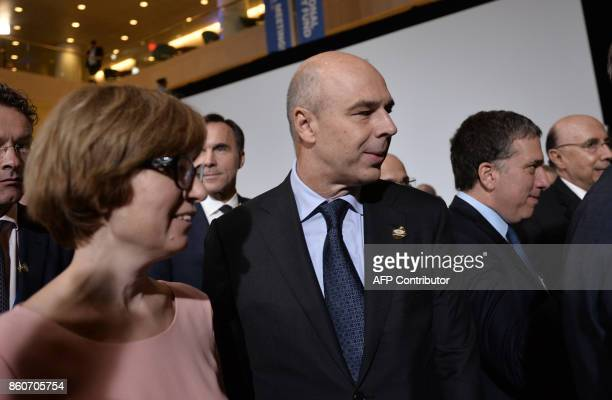 Russin Finance Minister Anton Siluanov leaves after the G20 Finance ministers group photo at the IMF headquarters in Washington DC on October 12 2017...