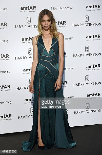 Russsian model Sasha Pivovarova poses as she arrives for the amfAR dinner on the sidelines of the Paris fashion week in Paris on July 5 2015 AFP...
