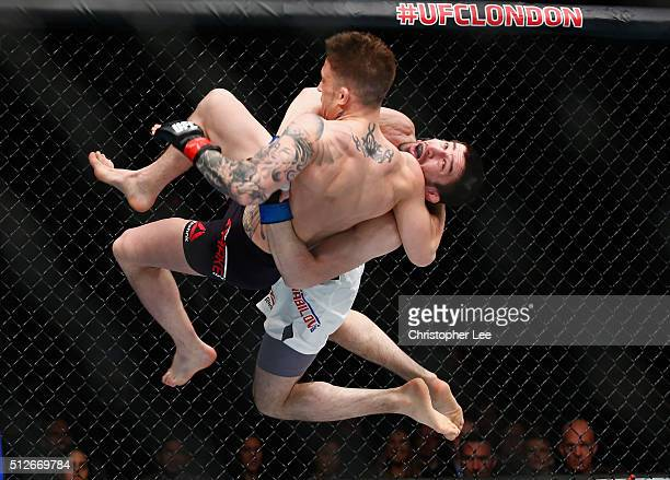 Rustam Khabilov of Russia throws Norman Parke of Nortern Ireland during the Middleweight Bout of the UFC Fight Night at The O2 Arena on February 27...