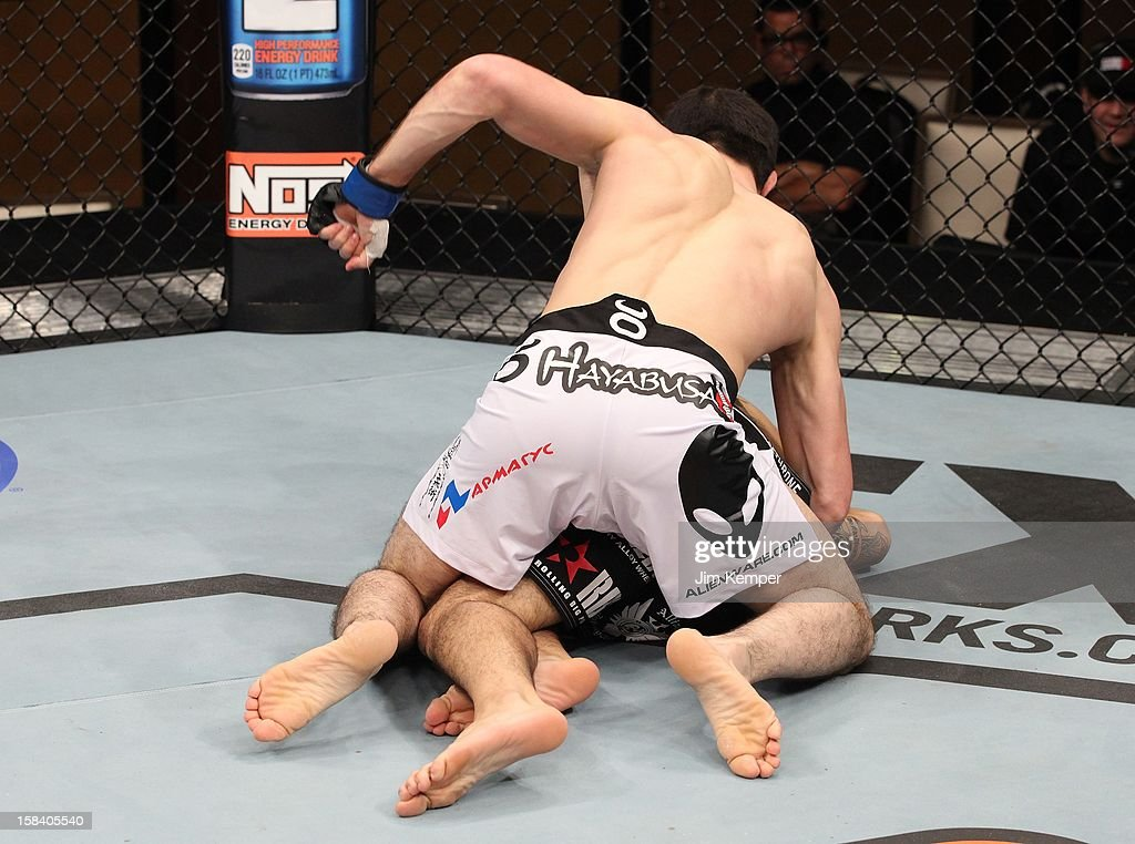 Rustam Khabilov (white shorts) punches Vinc Pichel during their lightweight fight at the TUF 16 Finale on December 15, 2012 at the Joint at the Hard Rock in Las Vegas, Nevada.