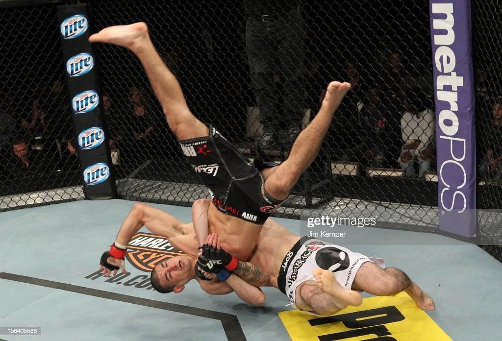 Rustam Khabilov (white shorts) slams Vinc Pichel during their lightweight fight at the TUF 16 Finale on December 15, 2012 at the Joint at the Hard Rock in Las Vegas, Nevada.