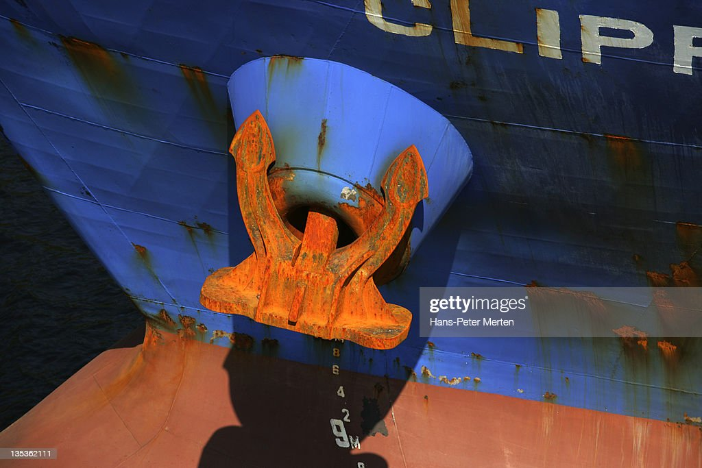 rusted anchor of a cargo chip : Stock Photo