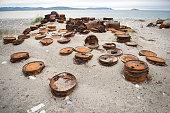 Rusted barrels on the shore, Chukotka, Russia
