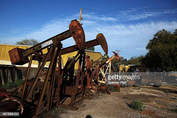 Rusted out 'pumpjacks' are viewed on March 26 2015 in the oil town of Luling Texas Texas which in just the last five years has tripled its oil...