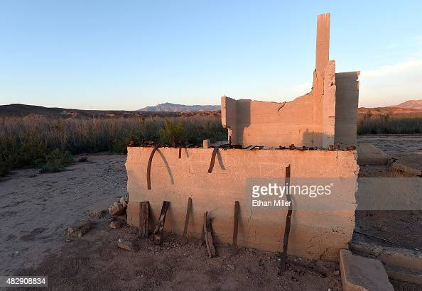 Rusted pieces of metal are shown on a wall of the ruins of the Hannig Ice Cream Parlor in the ghost town of St Thomas on August 3 2015 in the Lake...