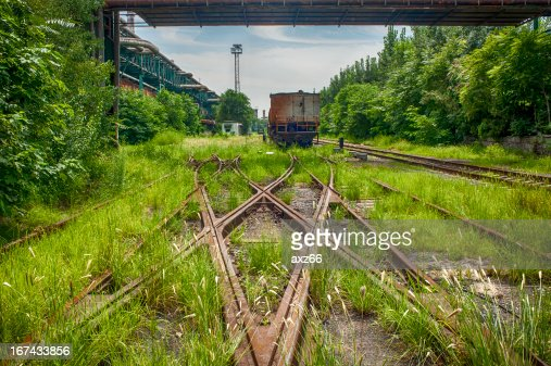 Rusted railway and abandoned carriage : Stock Photo