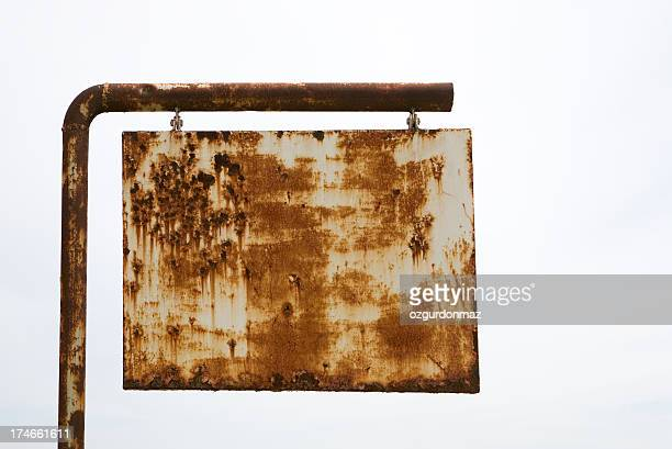 Rusted road sign