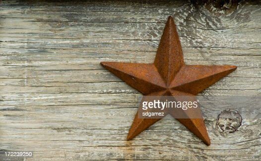 Rusted Texas star on a wooden platform