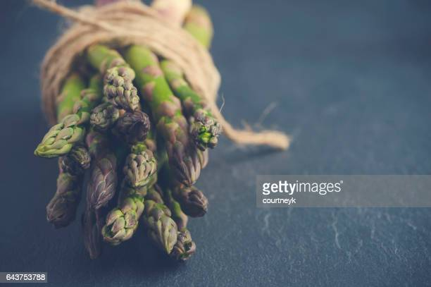 Rustic Asparagus bunch with string.