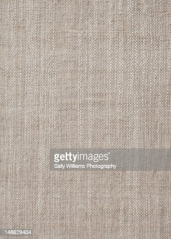 A rustic beige fabric background : Stock Photo