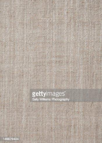 A rustic beige fabric background