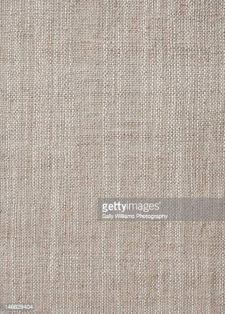 A rustic beige fabric background