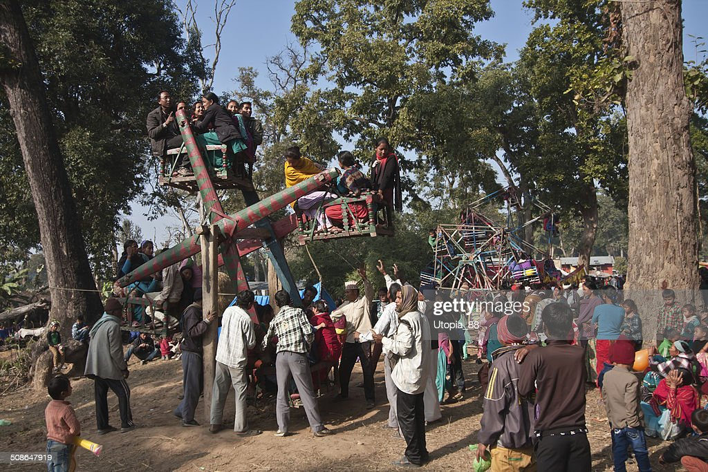 Rustic carousel fairground during Maggy festival Nepal : Stock Photo