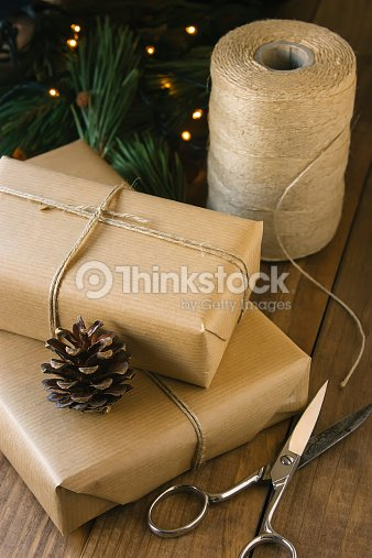 Rustic Christmas Gifts On Wooden Background Stock Photo | Thinkstock