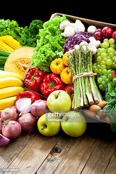 Rustic crate full of fruits and vegetables