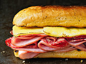 close up of rustic deli cold cuts sandwich
