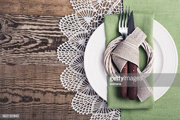 Rustic Easter place setting  on a rustic wooden table, top view