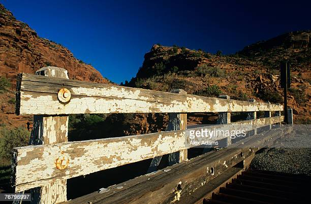 Rustic fence with chipped white paint in front of craggy mountains, Eastern Utah, Utah, USA