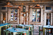 Old fashioned restaurant in absense of guests. Enterior design including wall paintings by Dejan Urosevic (property release included).