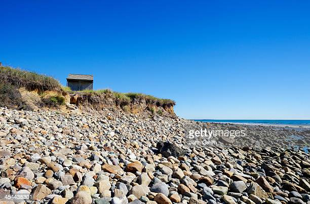 S VINEYARD MASSACHUSETTS UNITED STATES Rustic shack and stone beach