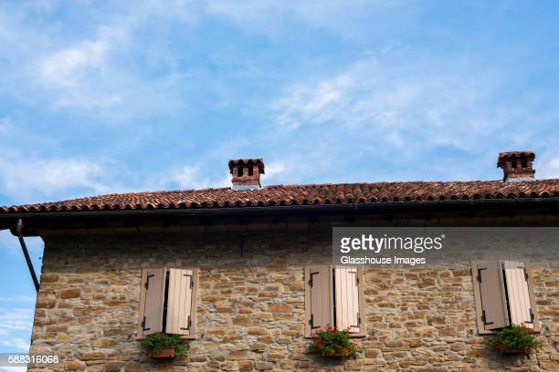 Rustic Stone House with Terracotta Roof and Shuttered Windows