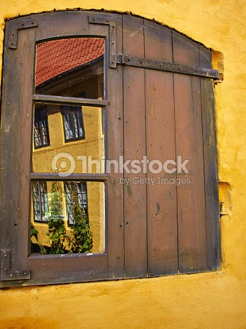 Rustic Window With Wooden Exterior Shutters Stock Photo | Thinkstock