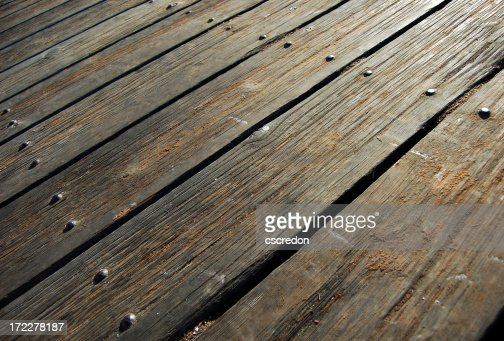 Rustic wood deck flooring with nails in line