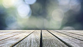 Rustic Wood Table Texture Over Blue Bokeh Background, Horizontal