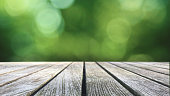 Rustic Wood Table Texture Over Green Spring Nature Blurred Background, Horizontal