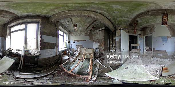 Rusting medical equipment stands in a room in the crumbling former hospital on April 9 2016 in Pripyat Ukraine Pripyat built in the 1970s as a model...