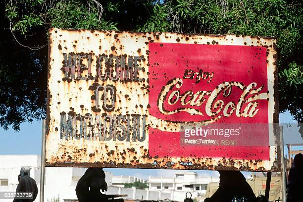 A rusty and bulletridden Coca Cola sign gives a telling welcome for visitors to the volatile city of Mogadishu In the 1980s civil war erupted in...