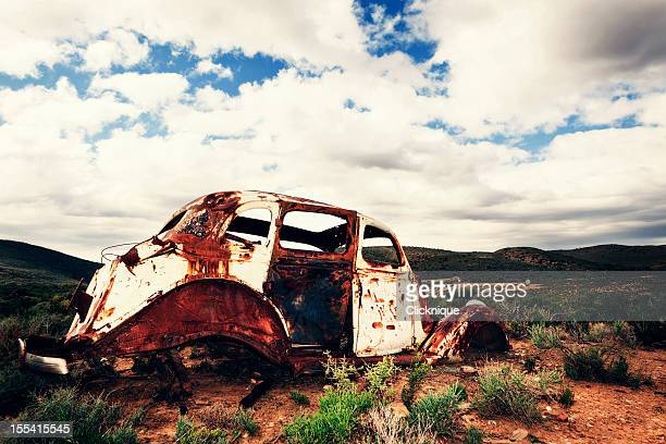 Rusty car abandoned in the middle of nowhere