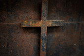 rusty cross - old and rusty cross iron door – rusty grunge background
