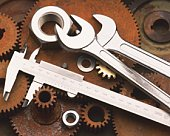 Rusty Gear and Brand New Industrial Tool