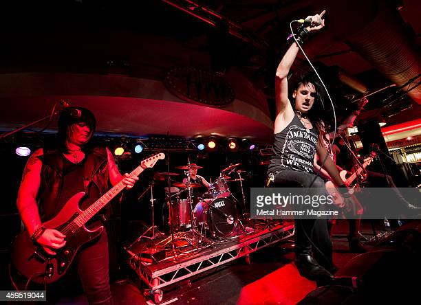 Rusty Gill Mick Sharp Johnny Gunn and Hex Panic of British glam metal group The Treatment performing live on stage at the 2013 Hard glam metal Hell...