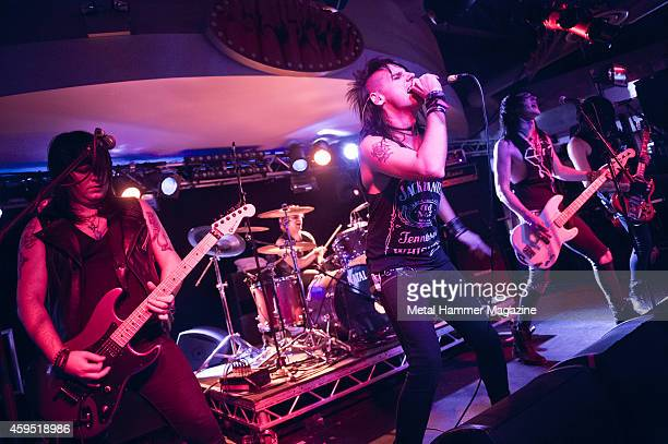 Rusty Gill Mick Sharp Johnny Gunn Hex Panic and Dagan Wilkin of British glam metal group The Treatment performing live on stage at the 2013 Hard glam...