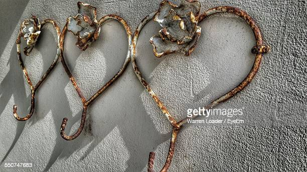 Rusty Hooks On Wall