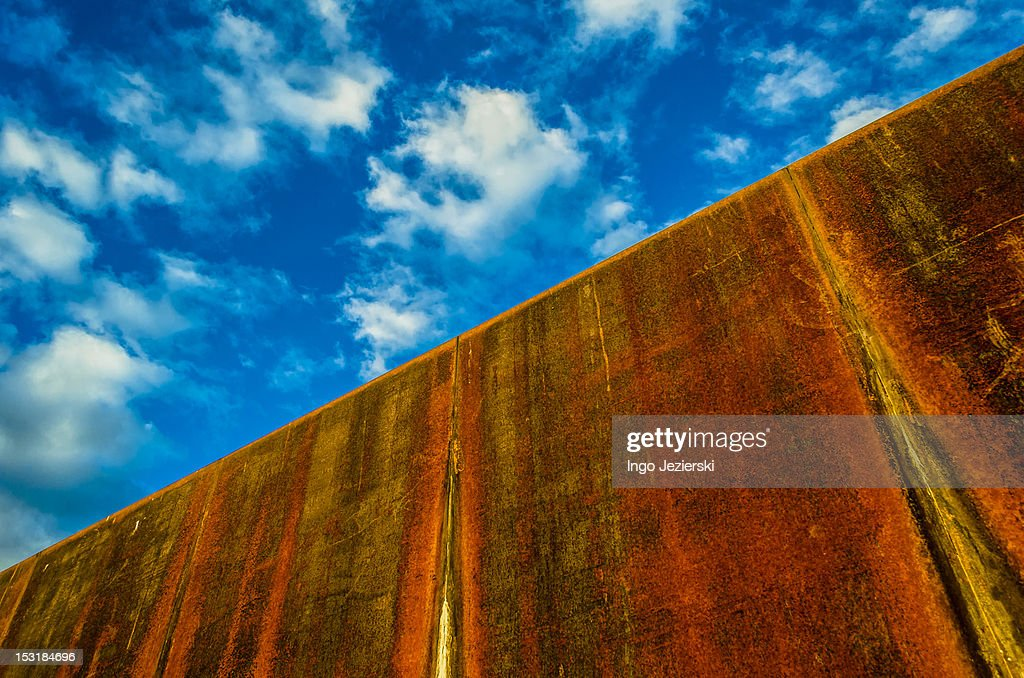 Rusty iron wall with clouds : Stock Photo