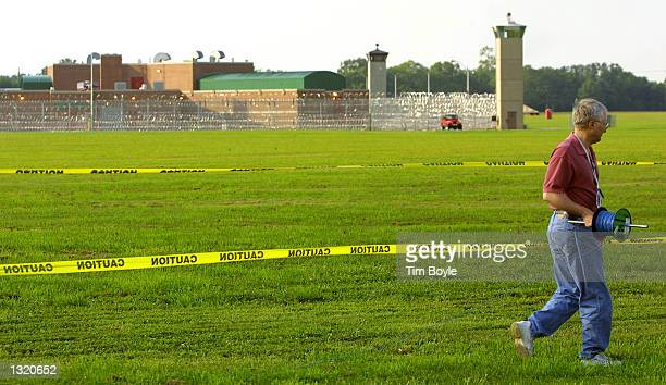 Rusty Lutz an ABC Radio producer from Washington DC rolls out audio cable June 8 2001 on the grounds of the US Federal Prison in Terre Haute Indiana...