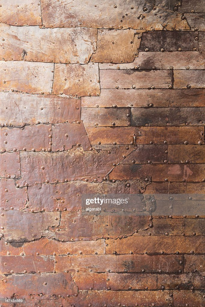 Rusty metal plate with a seam and rivets : Stock Photo