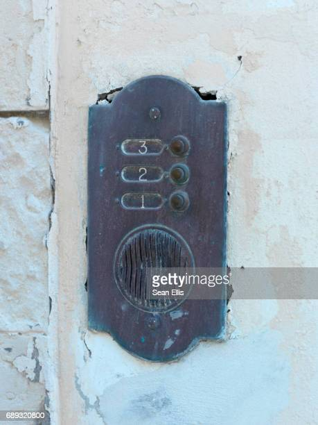 Rusty old intercom entry buzzer or bell