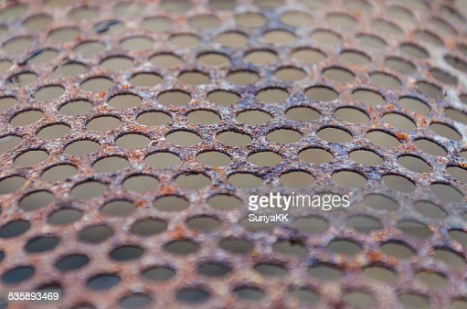Rusty perforated sheet : Stock Photo