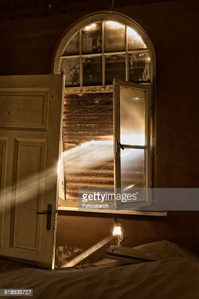 Rusty shutters with rays of sunlight